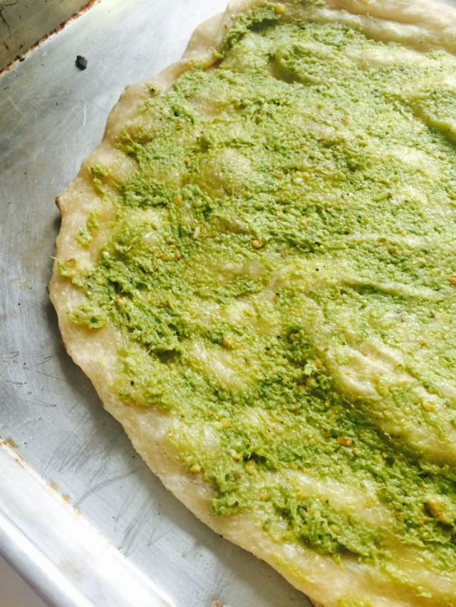 garlic scape pesto on pizza dough